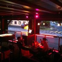 Photo taken at Damage Bar by Belinda M. on 5/28/2012