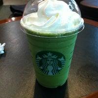 Photo taken at Starbucks by Shingo E. on 7/6/2012