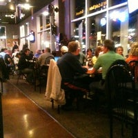 Photo taken at Tomato Jake's Pizzeria by Carmen H. on 2/23/2012