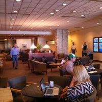 Photo taken at Delta Sky Club by Hungry H. on 7/3/2012