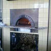 Photo taken at Olio Wood Fired Pizzeria by Kevin F. on 9/10/2011