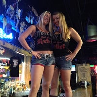 Photo taken at Coyote Ugly Saloon by Brent T. on 8/23/2012
