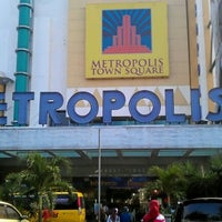 Photo taken at Metropolis Town Square by Harry H. on 7/20/2012