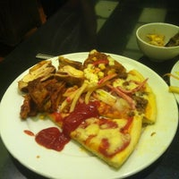 Photo taken at Pepperonis by Chung L. on 5/2/2012