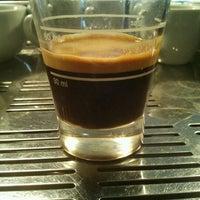 Photo taken at Buenavista Café by Ronaldo M. on 2/3/2012