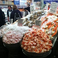 Photo taken at Pike Place Fish Market by Hyunyoung K. on 3/31/2012