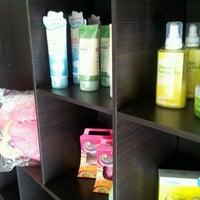Photo taken at Kkochipida (Top Korean Brand Cosmetic Shop) by Charmaine S. on 5/24/2012