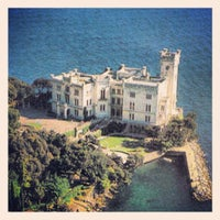 Photo taken at Castello di Miramare by Enrico M. on 5/25/2012