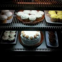 Photo taken at Cafe Aromas by Ravi B. on 2/22/2012