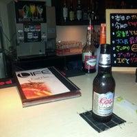 Photo taken at Water Bar LIFE by Tomonori K. on 10/16/2011