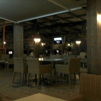 Photo taken at Captain Cafe Bar Restaurant by Makis R. on 9/14/2011