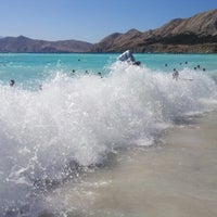 Photo taken at Baška Beach by Marko H. on 8/8/2012
