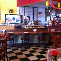 Photo taken at Arigato Japanese Restaurant by Laura G. on 2/11/2011