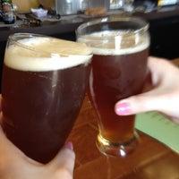 Photo taken at Vinomondo Wine Bar & Brew Pub by Ashley B. on 3/17/2012