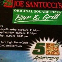 Photo taken at Joe Santucci's Square Pizza Bar and Grill by Alisa R. on 7/15/2011