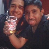 Photo taken at Mambo bar by Mario P. on 1/14/2012