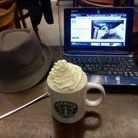 Photo taken at Starbucks by Michał S. on 1/16/2012