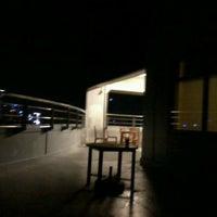 Photo taken at JP Morgan Chase Smoking & Parking Area by Rhon L. on 3/10/2012