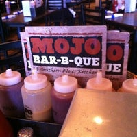 Photo taken at MOJO Bar B Que, A Southern Blues Kitchen by Phil and Debra M. on 5/24/2012