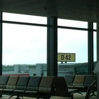 Photo taken at Gate D42 by Jeng @. on 1/26/2012
