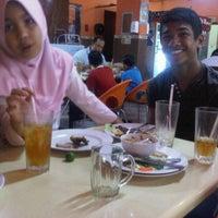 Photo taken at Nasi Dagang Ulik Mayang by Mohd Ikhsan M. on 11/28/2011