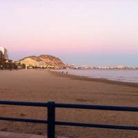 Photo taken at Postiguet Beach by Sebastiaan V. on 1/1/2012