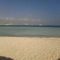 Photo taken at Playa Langosta by Mauricio C. on 3/24/2012