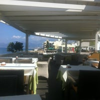 Photo taken at Palmera Seaside Restaurant by Anastasiya T. on 5/31/2012