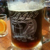 Photo taken at Oggis Pizza & Brewing Co by Ken H. on 10/15/2011