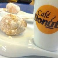 Photo taken at Café Donuts by Daniel I. on 7/28/2012