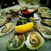 Photo taken at Van Rensselaer's Restaurant and Raw Bar by Menglin H. on 5/27/2012