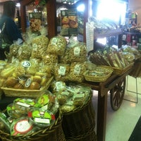 Photo taken at AJ's Fine Foods by Shannon M. on 12/10/2011