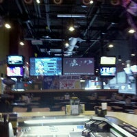 Photo taken at Buffalo Wild Wings by Carrie L. on 1/6/2012