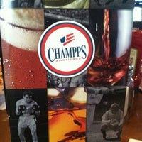 Photo taken at Champps Americana by Jonise B. on 7/22/2012