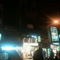 Photo taken at Defence Colony Market by Archan N. on 1/21/2011
