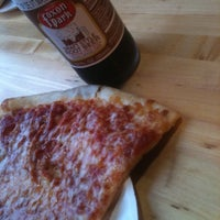 Photo taken at New York Pizzeria by Amy C. on 10/14/2011