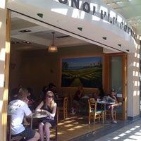 Photo taken at Honolulu Coffee Company by Malia H. on 1/1/2011
