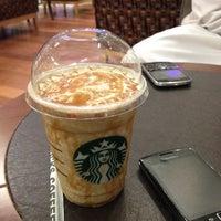 Photo taken at Starbucks by Hamda A. on 7/5/2012
