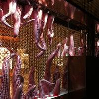 Photo taken at Louis Vuitton by 和彦 石. on 8/1/2012