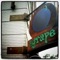Photo taken at The Grape Wine Bar & Bistro by Malik W. on 8/4/2011