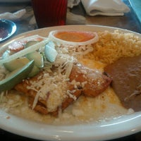 Photo taken at Polvos Mexican Restaurant by Russell P. on 3/13/2012