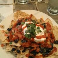 Photo taken at Johnny Mango World Café & Bar by Jennifer S. on 1/12/2012