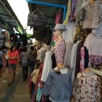 Photo taken at Sammakorn Weekend Market by Yommy D. on 3/4/2012