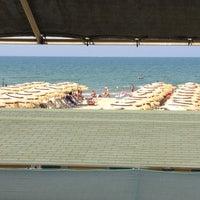 Photo taken at Bagno Delfino by Antonio P. on 6/30/2012