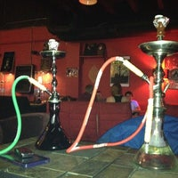Photo taken at Eastown Hookah Lounge by Tiffany B. on 5/15/2012