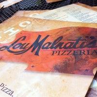 Photo taken at Lou Malnati's Pizzeria by Aaron B. on 7/13/2012