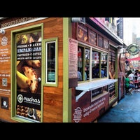 Photo taken at Nuchas Artisan Empanadas by Girl Gone Travel on 8/13/2012
