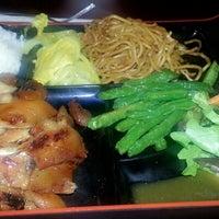 Photo taken at Bento Cafe by madhumita r. on 8/14/2012