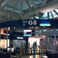 Photo taken at Gate G8 by Valeria B. on 9/3/2012