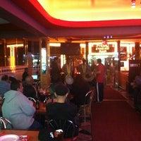 Photo taken at Singh's Roti Shop by Collin B. on 3/18/2012